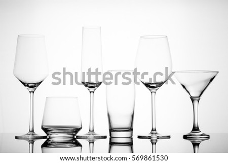 Superb Backlit Various Empty Alcoholic Glasses On Reflective Table