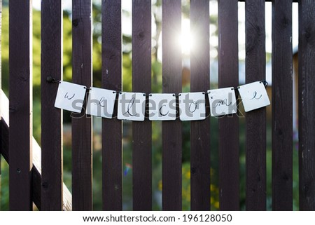 Backlit Welcome Sign on a Garden Entrance - stock photo