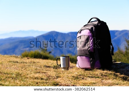 backpack and thermos in mountains, travel - stock photo