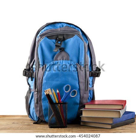 backpack, books and stationery for school isolated on a white background