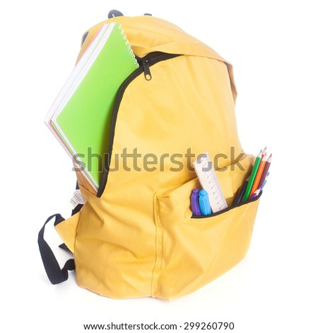 Backpack full of school supplies isolated on white - stock photo