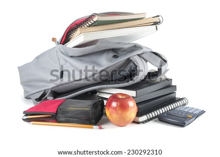 Backpack full of school supplies. on white background.  - stock photo