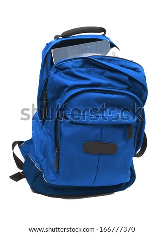 Backpack full with study books - stock photo