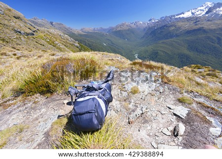 Backpack lying on Routeburn track - world renowned tramping (hiking) 32km track found in the South Island of New Zealand.