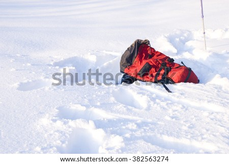backpack lying on the snow