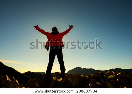 backpack taking a photo on the top of mountains, asian - stock photo