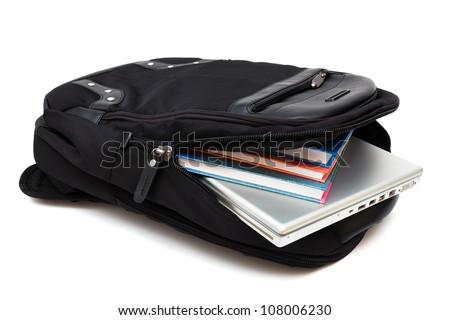 backpack with a laptop and books on white background