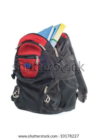 Backpack with books isolated on a white