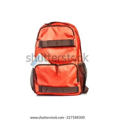 Backpack with map isolated on white background. Tourism and travel themes. Clipping path - stock photo