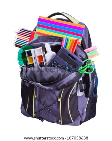 backpack with school supplies including, notebooks, pens, pencils, rulers and glue - stock photo