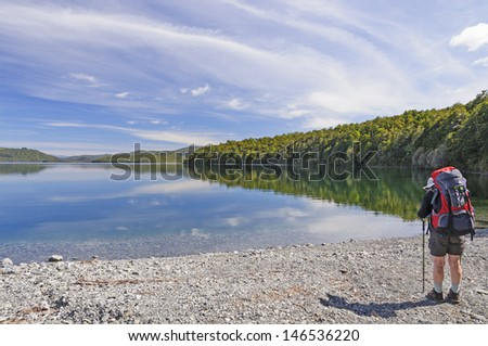 Backpacker on Lake Rotoiti in New Zealand - stock photo
