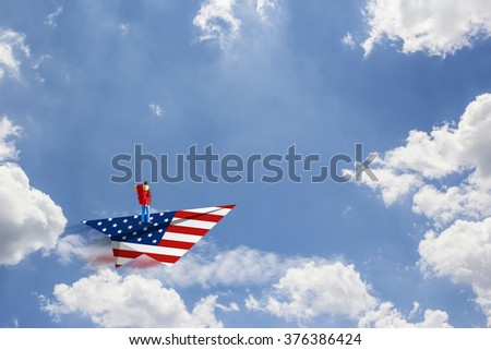 Backpacker on paper american airplane - stock photo