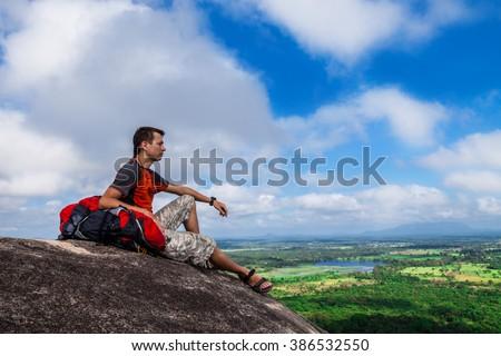 Backpacker on the top of mountain Pidurangala, Sri-Lanka - stock photo