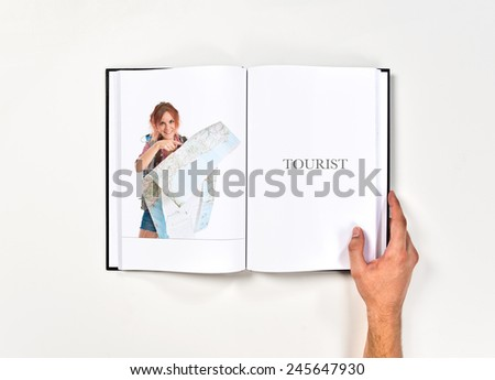 backpacker showing map  printed on book - stock photo