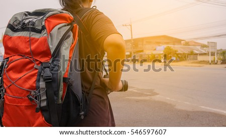 Backpacker tourist on highway.