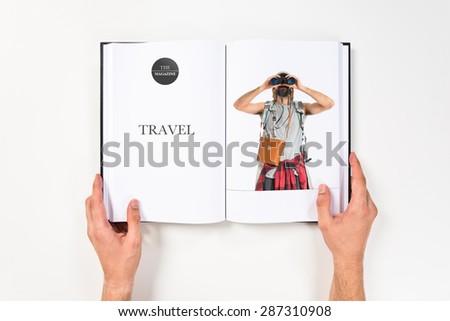 Backpacker with binoculars printed on book - stock photo