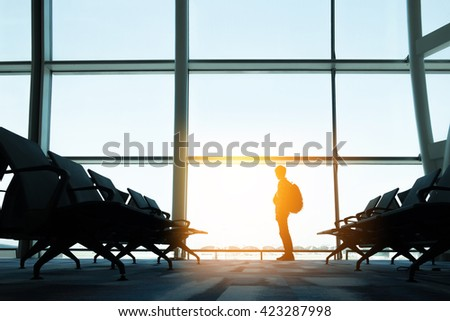 backpackers in airport. - stock photo