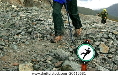 Backpackers on the Musical Bumps Alpine Route near Whistler, British Columbia, Canada. - stock photo