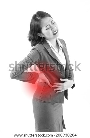 backpain of business woman, with red alert danger accent - stock photo