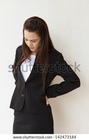 backpain of female business executive, concept of office syndrome with spinal or lower back problem - stock photo