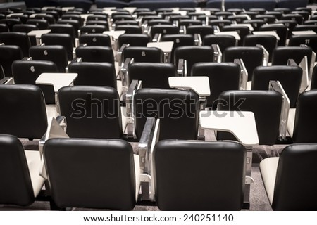 Backs of empty seats in auditorium - stock photo