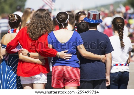 Backs of women pose for picture, July 4, Independence Day Parade, Telluride, Colorado, USA, 04.07.2014 - stock photo