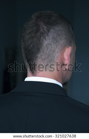 backside of a businessman with short hipster haircut - stock photo