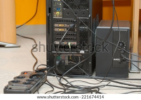 Backside of a computer with cables - stock photo