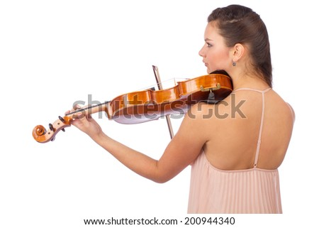 Backside of beautiful female violinist playing music isolated on a white background - stock photo