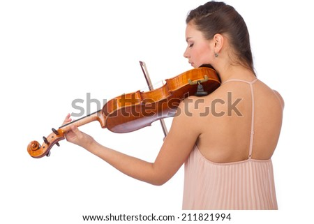 Backside of beautiful young woman posing with wooden viola over white background - stock photo