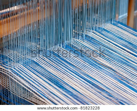 Backside of weaving loom - closeup of warp threads - stock photo