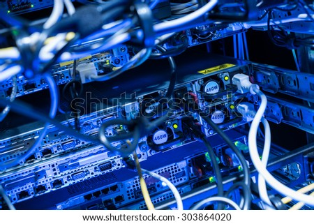 Backside of web servers in datacenter showing power connection cables - stock photo