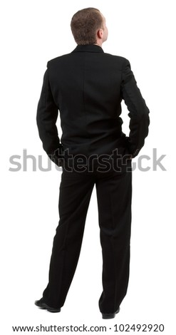 backside view of person. back view of Businessman looks ahead. Young guy in black suit  watching.  Rear view people collection.    Isolated over white background - stock photo