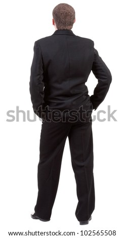 backside view of person. back view of Businessman looks ahead. Young guy in black suit  watching. Isolated over white background. Rear view people collection.