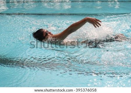 backstroke  in the swimming pool