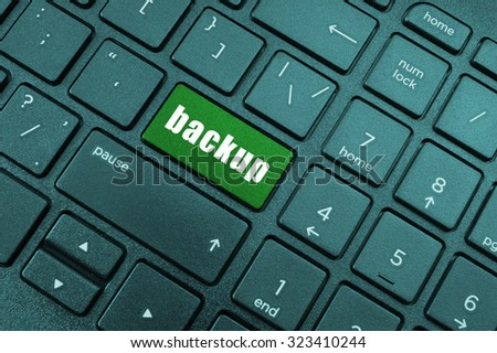 Backup computer key on laptop keyboard - stock photo