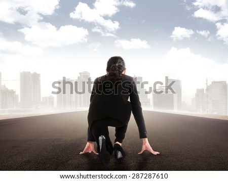 Backview of asian business woman  start run on the highway - stock photo