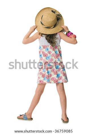 Backview of young girl in holiday clothes wearing large sunhat - stock photo