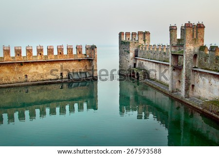 Backwater inside the Scaliger Castle - medieval port fortress, Sirmione, Italy - stock photo