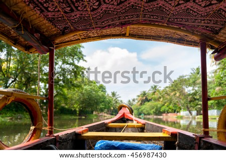 Backwaters in Kerala, beautiful Indian landscape photographed from a traditional boat