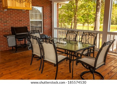 Backyard deck in residential house overlooking lake - stock photo