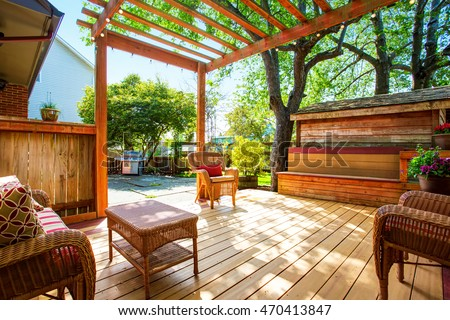 Backyard Deck With Wicker Furniture And Pergola. Northwest, USA