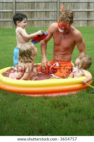 Backyard fun with the family in the kiddie pool