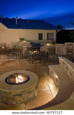 Backyard With Fire Pit, Outdoor Kitchen And Flagstone Patio Patio