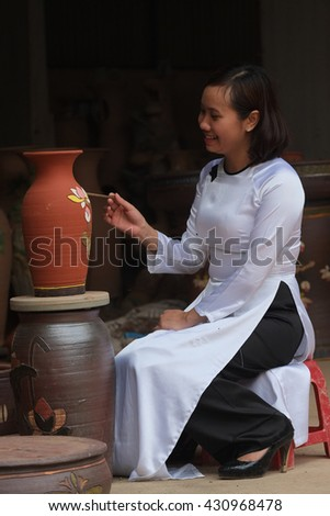 BACNINH, VIETNAM - MAY 08, 2016: Workers producing handmade art vase earthenware. This is a famous village traditional craft  in Vietnam.