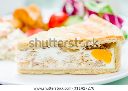 Bacon and egg pie with ships and salad
