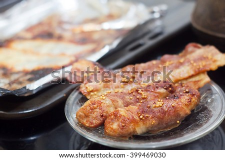 bacon and meat backed in oven - stock photo
