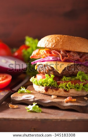 bacon cheese burger with beef patty tomato onion - stock photo