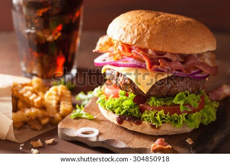 bacon cheese burger with beef patty tomato onion cola - stock photo