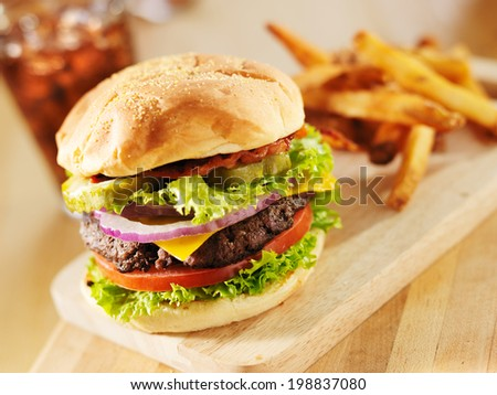bacon cheeseburger with lettuce and tomato - stock photo